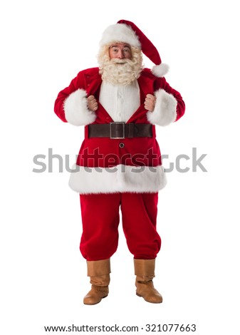 Santa Claus Portrait in a classic superman pose tearing his shirt open as a copyspace - stock photo
