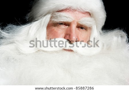 Santa Claus portrait smiling isolated over a black background - stock photo