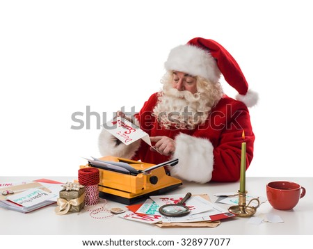 Santa Claus reading children letters and writing responses to them Closeup Portrait - stock photo