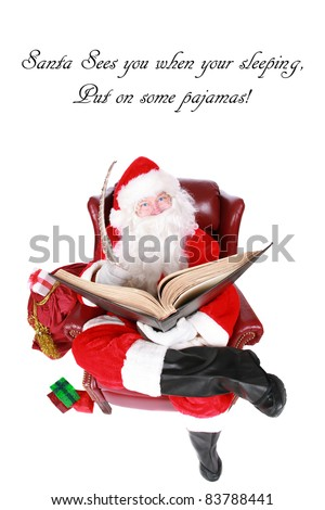 """Santa Claus reads from his book of Who has been """"Naughty or Nice"""" isolated on whtie with room for your text. Shot with a Fisheye lens for a fun festive image. - stock photo"""