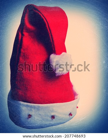 Santa Claus red hat on a light background, closeup - stock photo