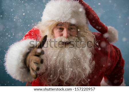Santa Claus running outdoors at North Pole. Trying to be in time working on delivery gifts to children - stock photo