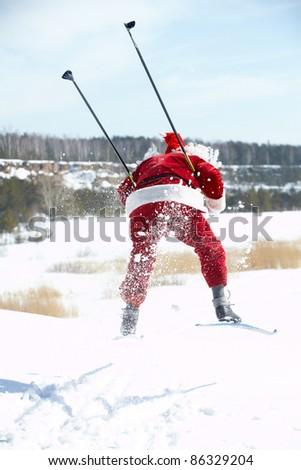 Santa Claus rushing on skies - stock photo