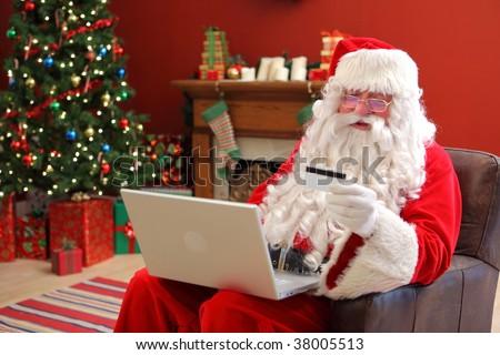 Santa Claus shopping online - stock photo