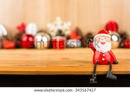 Santa claus 2016 sit down on the wood board