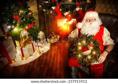 Santa Claus sitting at home with gifts, dressed in his home clothes. Christmas. Decoration. - stock photo
