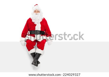 Santa Claus sitting on a blank billboard isolated on white background - stock photo