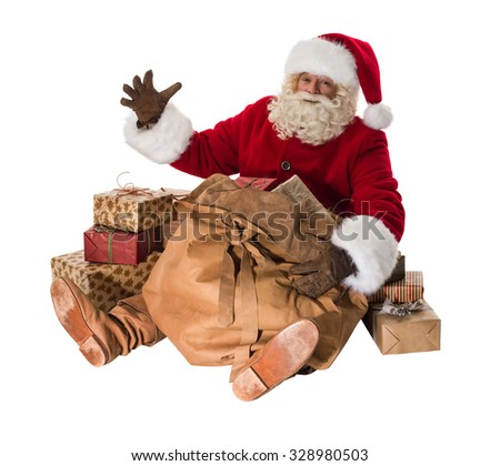 Santa Claus sitting with his big bag full of gifts and toys Full-Length Portrait - stock photo