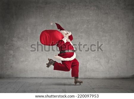 Santa Claus skating fast  - stock photo