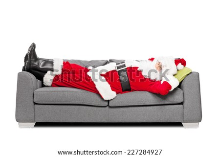 Santa Claus sleeping on a modern sofa isolated on white background - stock photo