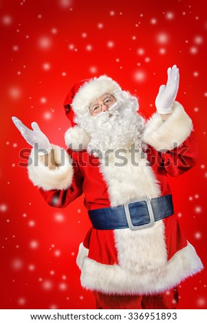 Santa Claus spreads his arms to the sides, expressing joy and surprise. Red background. Studio shot. Christmas. - stock photo