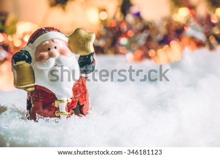 Santa claus stand in silent night with a light bulb, light up the hopefulness and happiness in Merry christmas and new year night. - stock photo