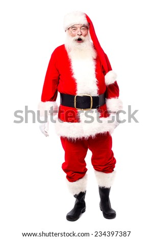 Santa claus standing isolated over white - stock photo