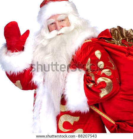 Santa Claus standing up on white background with his bag full of gifts - stock photo