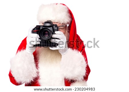Santa-claus taking picture with his new camera - stock photo