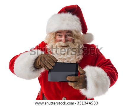 Santa Claus using tablet computer Closeup Portrait. Isolated on White Background - stock photo
