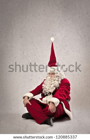 Santa Claus with a pointed christmas hat - stock photo