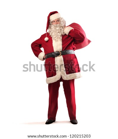 Santa Claus with his sack full of presents - stock photo