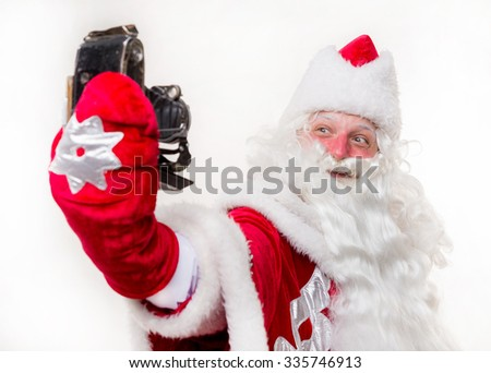 Santa Claus with old camera on white background. Isolated - stock photo