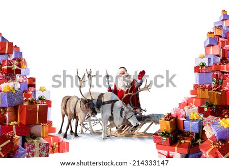 Santa Claus with reindeer stand beside the huge amount of gifts, which he is going to give for you during Christmas, isolated on white background - stock photo