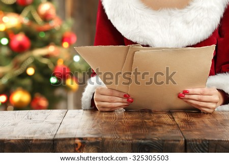 santa claus woman and paper - stock photo