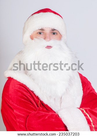 Santa Claus wriggles having put hands before a breast - stock photo