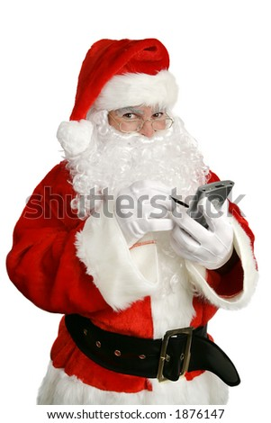 Santa Clause making his list on his personal computer.  Isolated over white. - stock photo