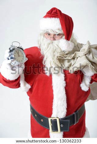 santa clause with alarm clock - stock photo