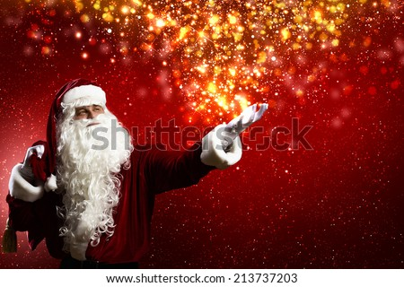 Santa Clause with gift bag behind shoulders - stock photo