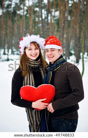 Santa couple with red heart - stock photo