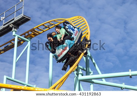 SANTA CRUZ, CALIFORNIA, USA-NOVEMBER 15, 2014 : People on Northern`s California only spinning coaster. Track lenght 1410 ft and maximum speed is up to 40 mph. Taken in Santa Cruz Beach Boardwal Park - stock photo