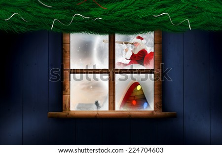 Santa delivery presents to village against fir branch christmas decoration garland - stock photo