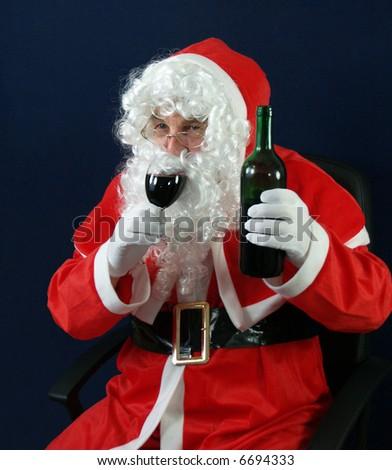 Santa drinking everyones health at Christmas - stock photo