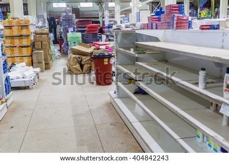 SANTA ELENA DE UAIREN, VENEZUELA - AUGUST 12, 2015: Empty shelves in a supermarket. Shortages of basic supplies are common in Venezuela. - stock photo