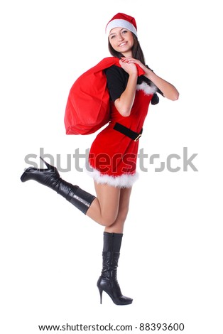 Santa girl with present - stock photo