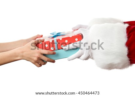 Santa hands give present to kid, isolated on white - stock photo