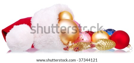 Santa Hat and Christmas-tree decorations on white - stock photo