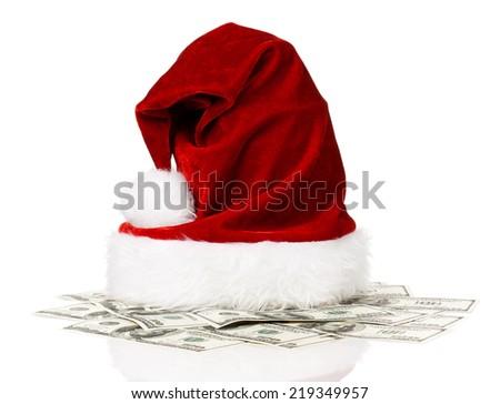 Santa hat on dollars isolated on white background - stock photo
