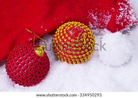 Santa hat with christmas balls - stock photo