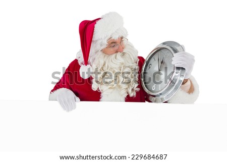 Santa holding a clock and sign on white background - stock photo