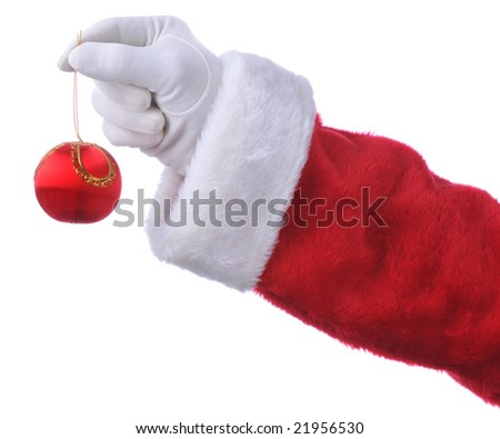 Santa Holding Christmas Ornament isolated over white - hand and arm only - stock photo