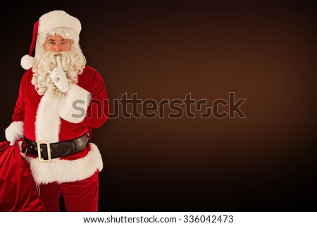 Santa holding his sack and keeping a secret against white background with vignette - stock photo