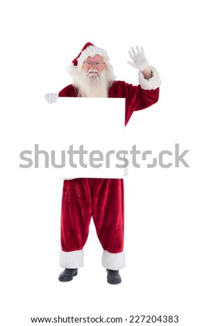 Santa holds a sign and is waving on white background - stock photo
