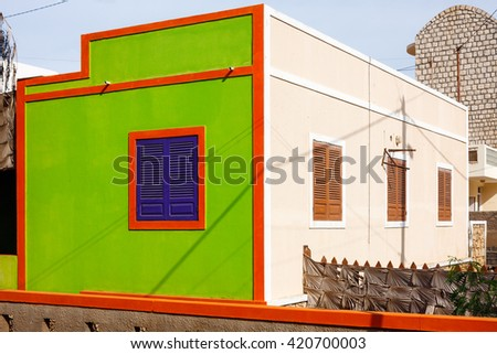 SANTA MARIA, CAPE VERDE - DECEMBER 17, 2015: Colorful architecture of Cape Verde, orange green residential  house - stock photo