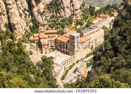 Santa Maria de Montserrat Abbey in Monistrol de Montserrat. View from cableway. - stock photo