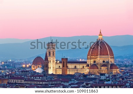 Santa Maria del Fiore, the Florence Duomo, in the evening sun with pink and blue skyline - stock photo