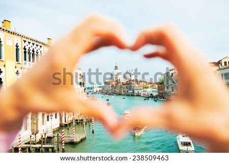 Santa maria della salute venice, italy framed by heart shaped hands - stock photo