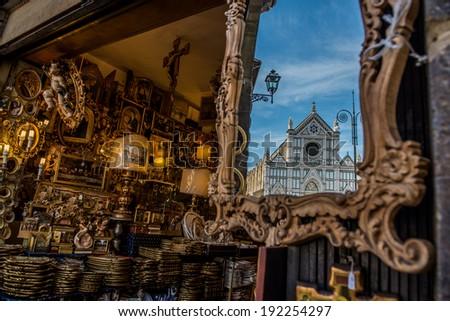 Santa Maria Novella church reflected in a mirror of an antiquarian boutique - stock photo