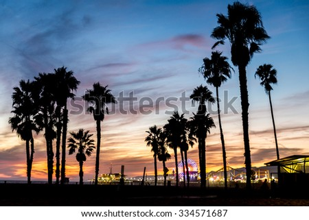 Santa Monica beach and pierat sunset, Los Angeles - stock photo