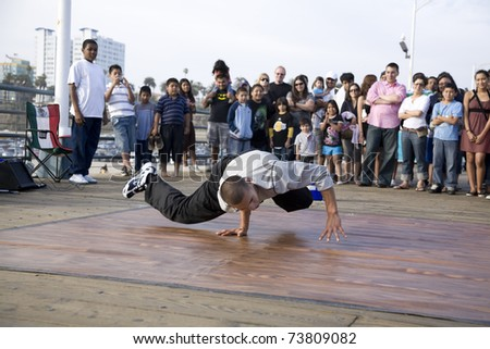 SANTA MONICA, CA - May 3, 2008:  B-Boy street performer break dances for the crowd on May 3, 2008 in Santa Monica, CA. - stock photo